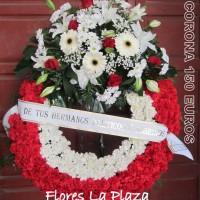 Corona de clavel y rosas en cabecero 150€